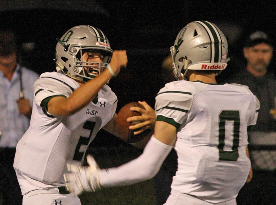 Bridgewater,MA Sept 6, 2018......BRIDGEWATER-RAYNHAM ....VS.....DUXBURY HS . . . IN SEASON OPENER FOR BOTH.........( George Rizer for the Boston Globe) for SPORTS.....Duxbury QB #2 John Roberts celebrates long 1st qtr TD run with teammate Will Prouty....