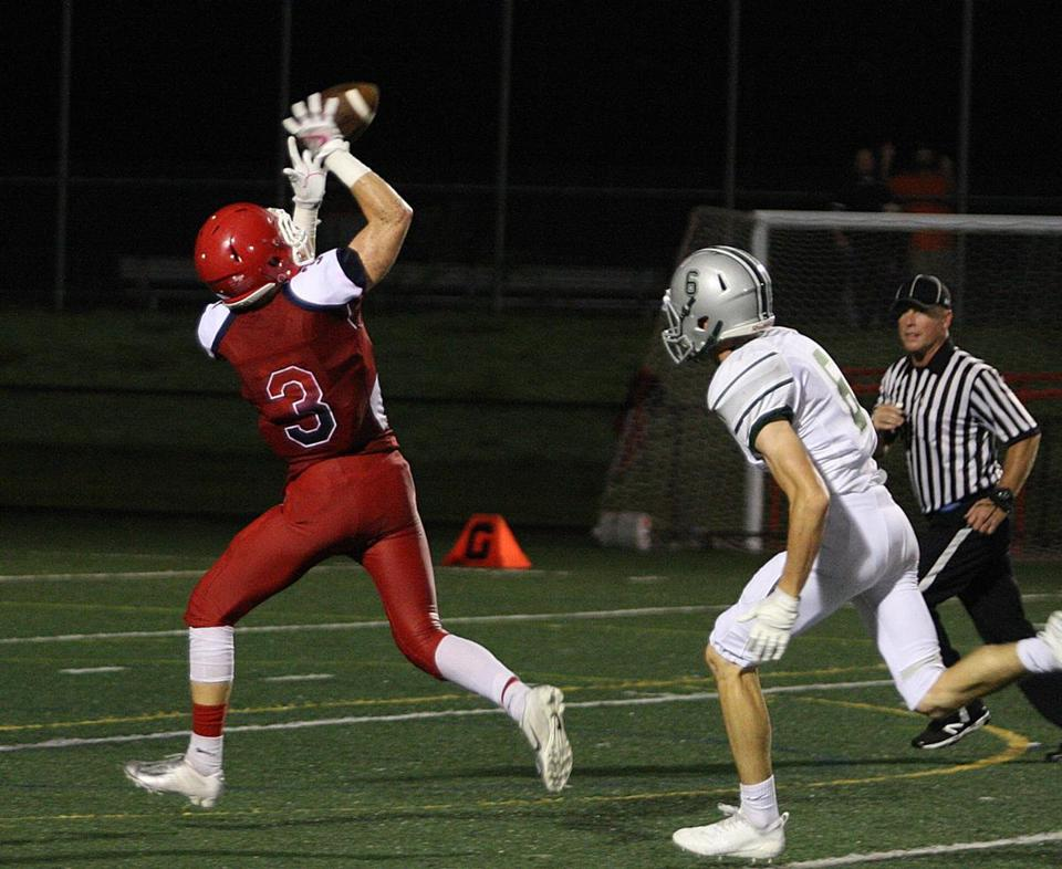 Bridgewater-Raynham's Shane Fries hauls in a 29-yard TD pass from Anthony Morrison.