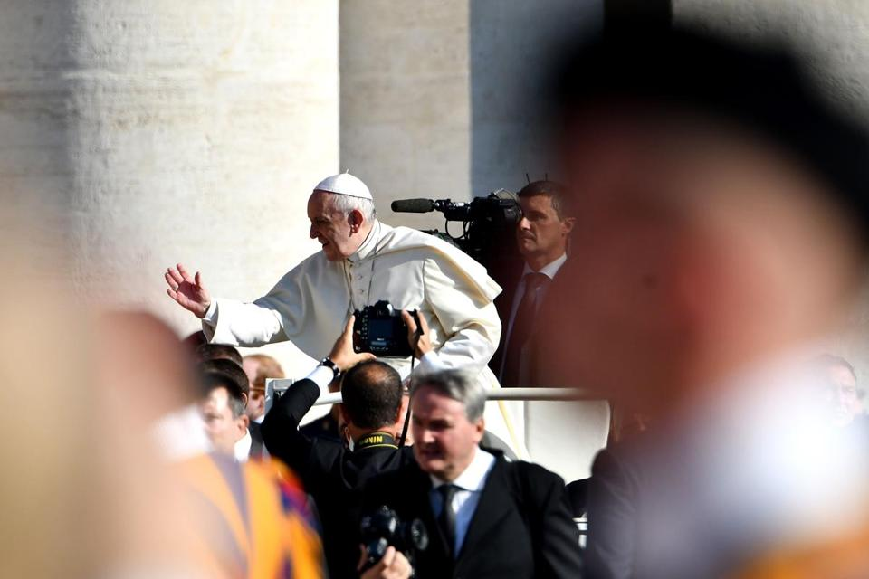 Pope Francis waved to the faithful Wednesday upon his arrival at St Peter's Square.