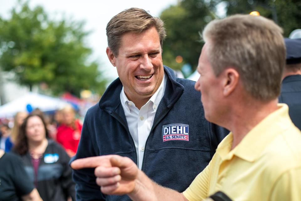 Republican candidate for US Senate Geoff Diehl in Norwood greeted Kevin Pentowski of Norwood on Saturday at Norwood Day.