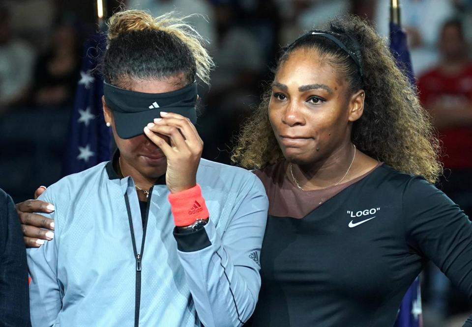 Serena Williams, winner of 23 Grand slam tournaments, supports Naomi Osaka (left), after she won her first, the US Open.