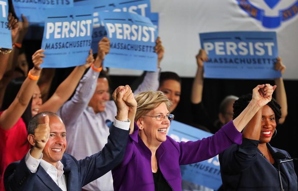 At the end of her speech, US Senator Elizabeth Warren (center) joined hands in support with gubernatorial candidate Jay Gonzalez (left) and US House candidate Ayanna Pressley.