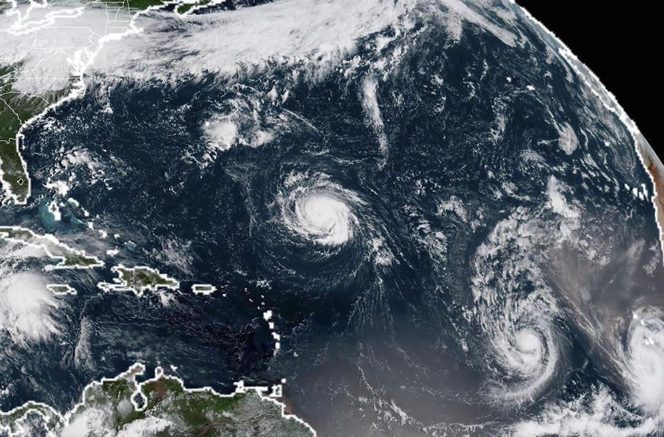 Satellite imagery from early Sunday showed (from left) Hurricane Florence, Tropical Storm Isaac, and Tropical Storm Helene in the Atlantic Ocean.
