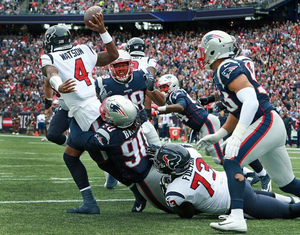 Malcom Brown had Texans quarterback Deshaun Watson in his grasp, forcing him to throw the ball away.