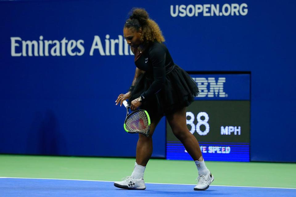 NEW YORK, NY - SEPTEMBER 08: Serena Williams of the United States walks off after smashing her racket during her Women's Singles finals match against Naomi Osaka of Japan on Day Thirteen of the 2018 US Open at the USTA Billie Jean King National Tennis Center on September 8, 2018 in the Flushing neighborhood of the Queens borough of New York City. (Photo by Chris Trotman/Getty Images for USTA)