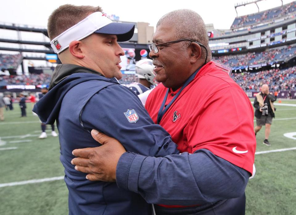 Patriots offensive coordinator Josh McDaniels and Texans defensive coordinator Romeo Crennel met on the field after the game.
