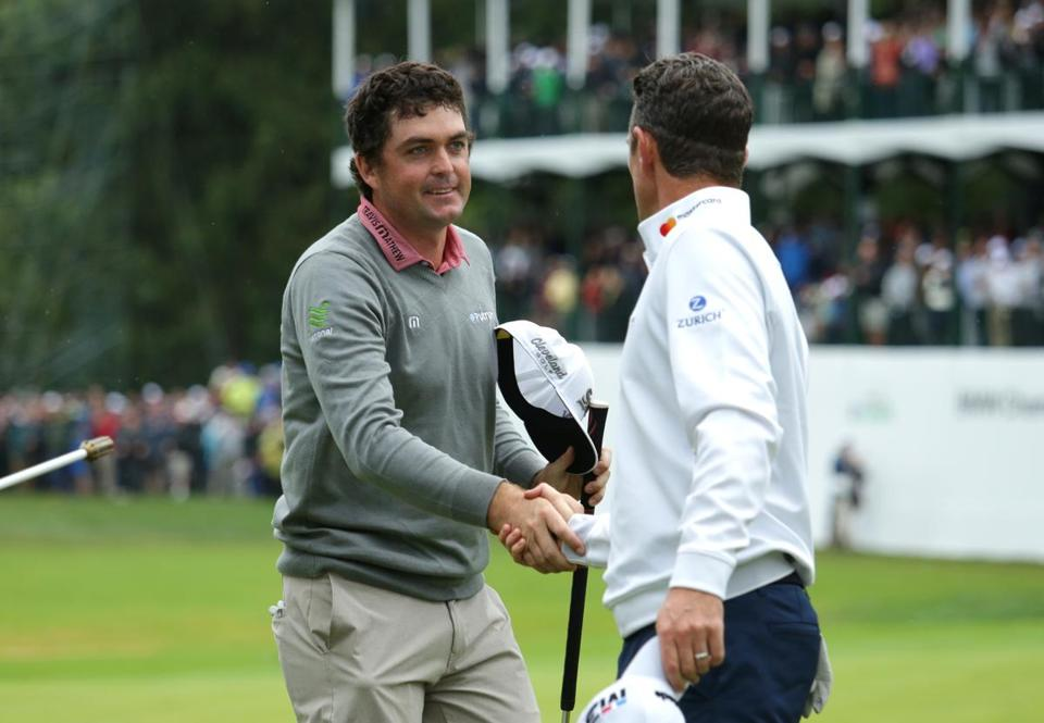 NEWTOWN SQUARE, PA - SEPTEMBER 10: Keegan Bradley shakes hands with Justin Rose of England after winning a one hole playoff of the weather delayed final round of the BMW Championship at Aronimink Golf Club on September 10, 2018 in Newtown Square, Pennsylvania. (Photo by Hunter Martin/Getty Images)