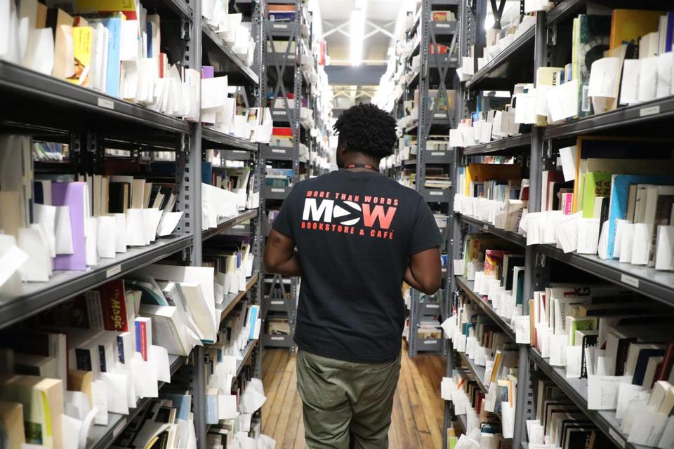 Mehki Jordan walked down an aisle in the internet and Web sales warehouse at the expanded More Than Words bookstore in the South End.