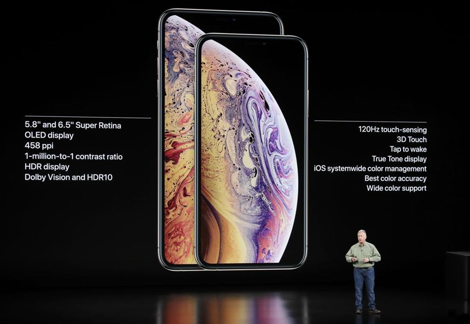 Phil Schiller, Apple's senior vice president of worldwide marketing, speaks about the Apple iPhone XS and Apple iPhone XS Max at the Steve Jobs Theater during an event to announce new Apple products Wednesday, Sept. 12, 2018, in Cupertino, Calif. (AP Photo/Marcio Jose Sanchez)