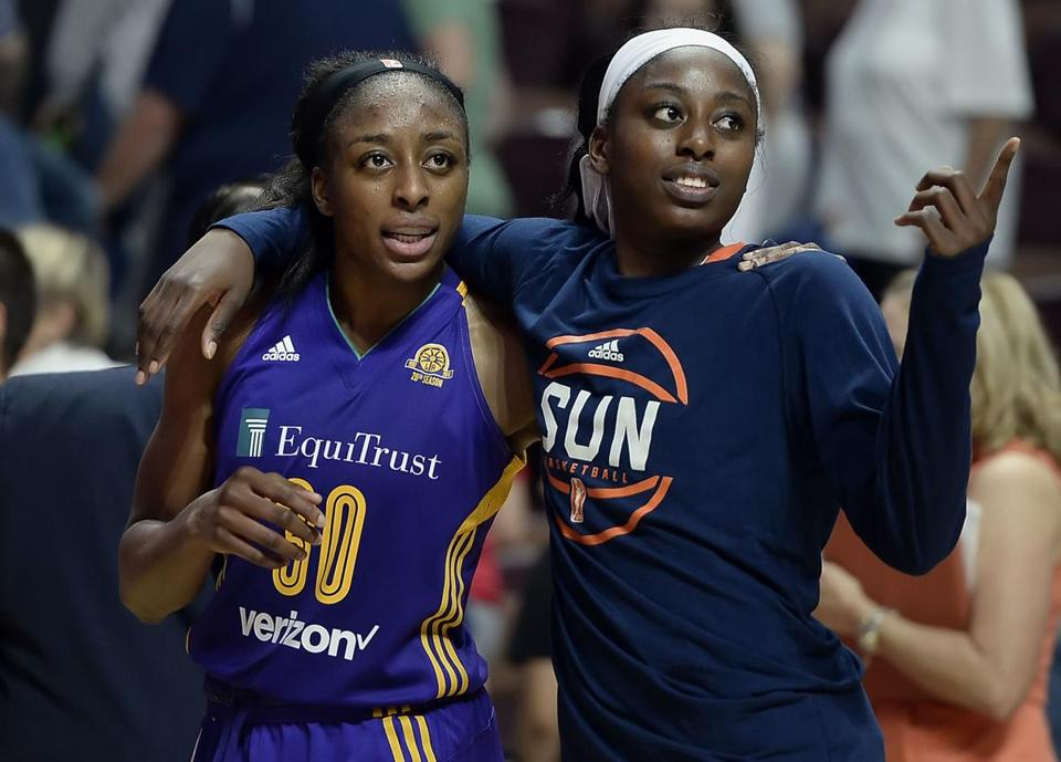 FILE - In this May 26, 2016, file photo, sisters Los Angeles Sparks' Nneka Ogwumike, left, and Connecticut Sun's Chiney Ogwumike, right, walk off the court together at the end of a WNBA basketball game between the their teams, in Uncasville, Conn. Chiney Ogwumike remembers her father always telling her and her sisters that every disappointment is a blessing. The Connecticut Sun star followed that advice, turning two season-ending injuries into what could be a television career. ESPN on Tuesday, May 1, 2018, announced she will be a fulltime basketball analyst. At 26, she is one of the youngest analysts at the network and one of few women in that role.(AP Photo/Jessica Hill, File)