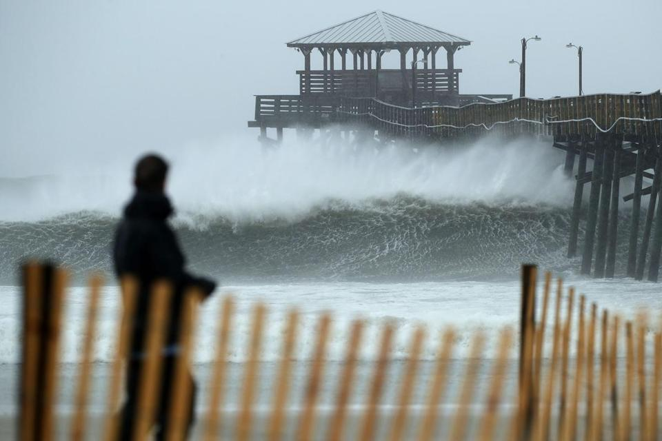 The outer bands of Hurricane Florence sent waves crashing in Atlantic Beach, N.C.