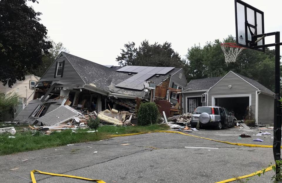 A house was destroyed in Lawrence, Mass., on Thursday.