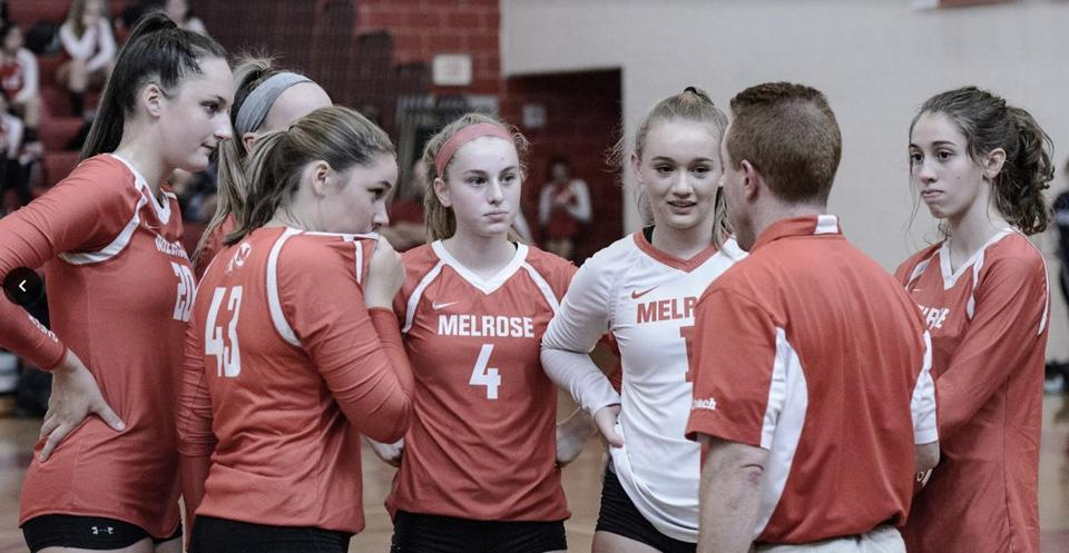 14schgvolley - Melrose coach Scott Celli addresses his team. Junior libero and captain Nicole Abbott is in the white jersey. (Steve Karampalas)