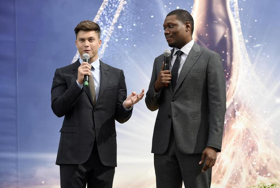 Colin Jost (left) and Michael Che will host the Emmy Awards on Monday.