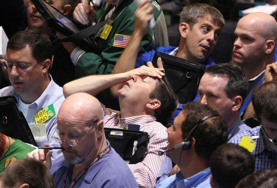 FILE- In this Sept. 16, 2008, file photo traders work in the product options pit at the New York Mercantile Exchange in New York. Home prices had sunk, and foreclosure notices began arriving. Layoffs began to spike. Tremors intensified as Lehman Brothers, a titan of Wall Street, slid into bankruptcy on Sept. 15, 2008. Stock markets shuddered and then collapsed in a cascading panic that government officials struggled to stop. The financial crisis touched off the worst recession since the 1930s Great Depression. (AP Photo/Seth Wenig, File)