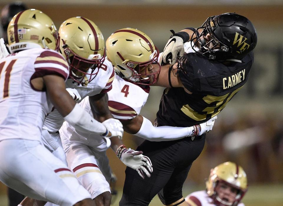 WINSTON SALEM, NC - SEPTEMBER 13: Hamp Cheevers #4 of the Boston College Eagles tackles Cade Carney #36 of the Wake Forest Demon Deacons during their game at BB&T Field on September 13, 2018 in Winston Salem, North Carolina. (Photo by Grant Halverson/Getty Images)