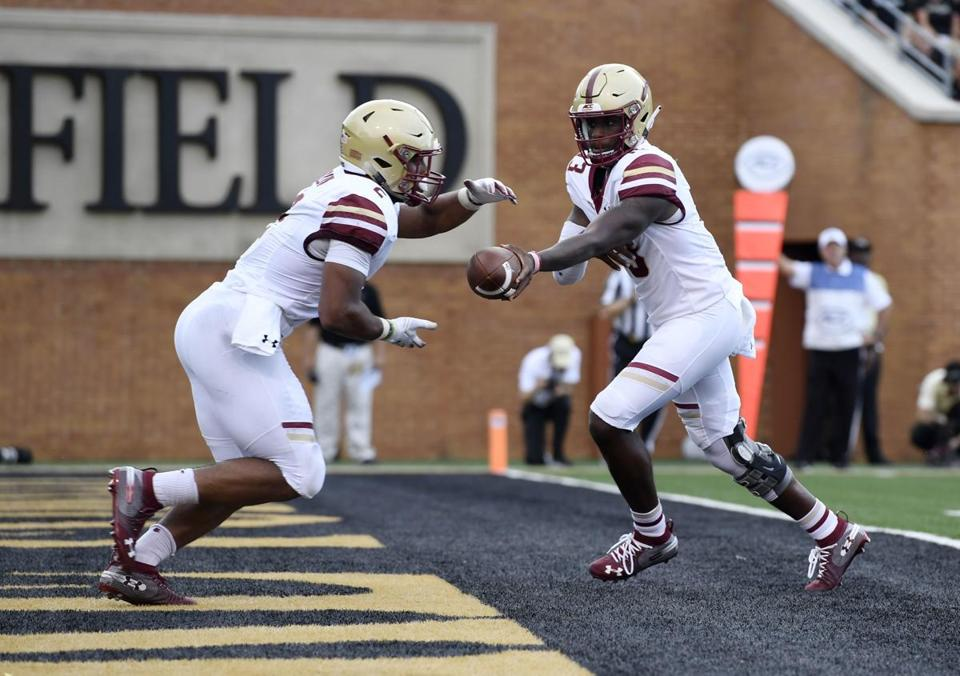 Boston College running back AJ Dillon (2) takes a handoff from quarterback Anthony Brown (13) during the first half of an NCAA college football game against Wake Forest, Thursday, Sept. 13, 2018, in Winston-Salem, N.C. (AP Photo/Woody Marshall)