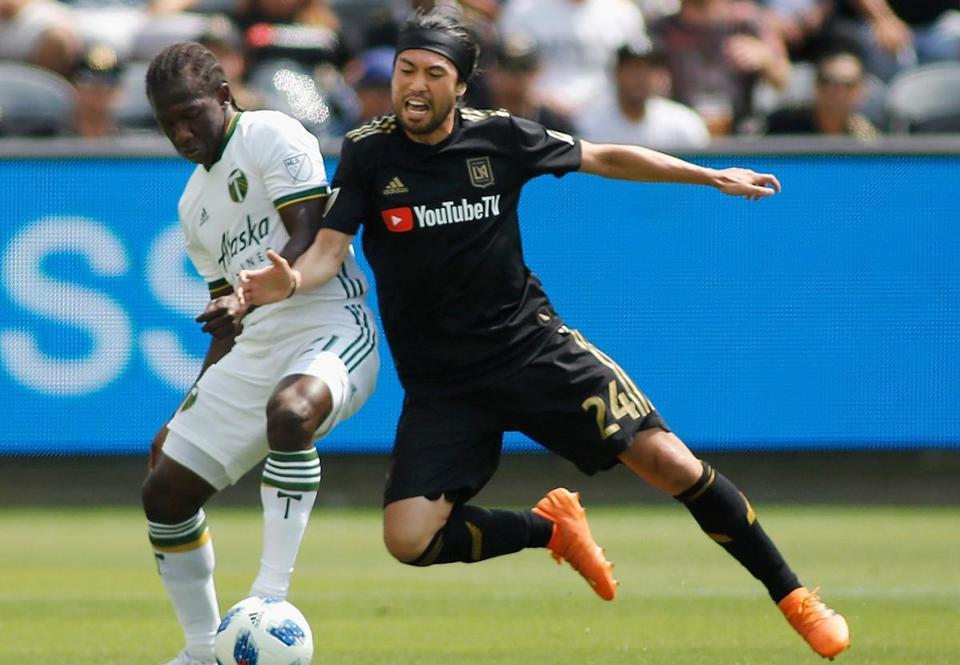 LOS ANGELES, CA - JULY 15: Diego Chara #21 of the Portland Timbers and Lee Nguyen #24 of the Los Angeles Football Club battle for control of the ball at Banc of California Stadium on July 15, 2018 in Los Angeles, California. (Photo by Katharine Lotze/Getty Images)
