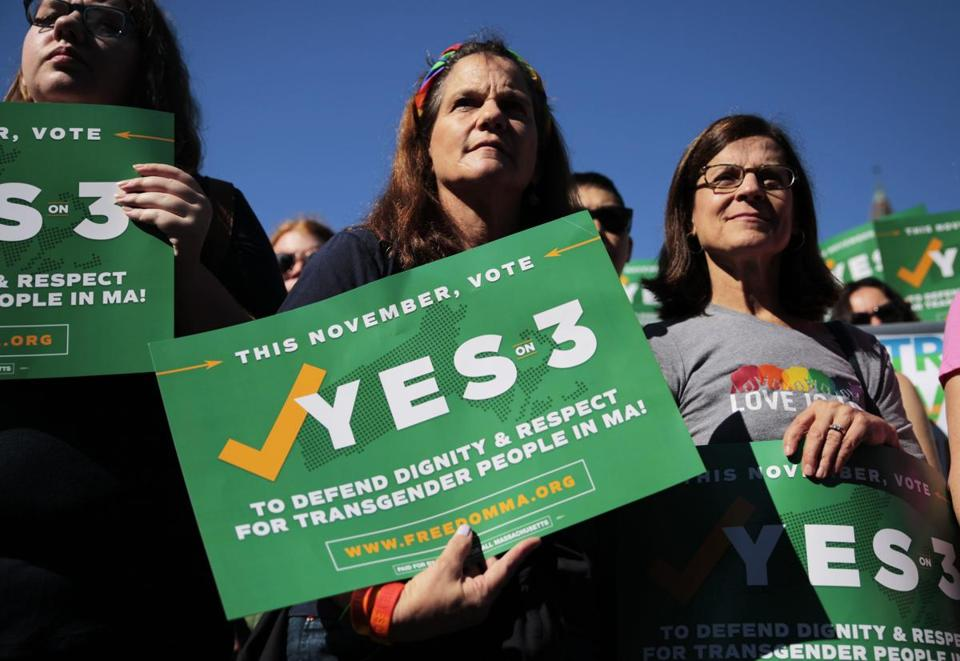 "Boston, MA - 9/16/2018 - Camille Ernst (middle) and Joanne Hooker (right) hold signes for a ""Vote Yes on 3"" rally in Copley Square regarding Transgender laws in Massachusetts. (Michael Swensen for The Boston Globe) Topic: (metro)"