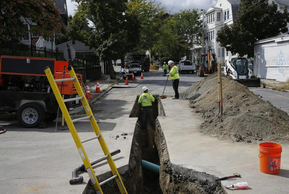 Gas workers tended to pipes off of Brookfield Street in South Lawrence earlier this month