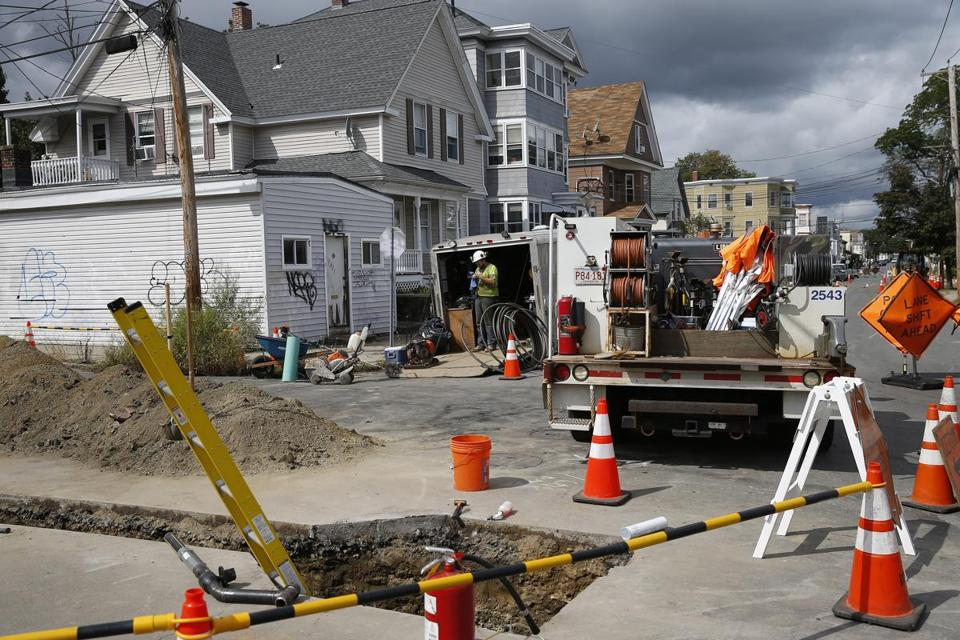 A gas worker took a break on Brookfield Street in South Lawrence.