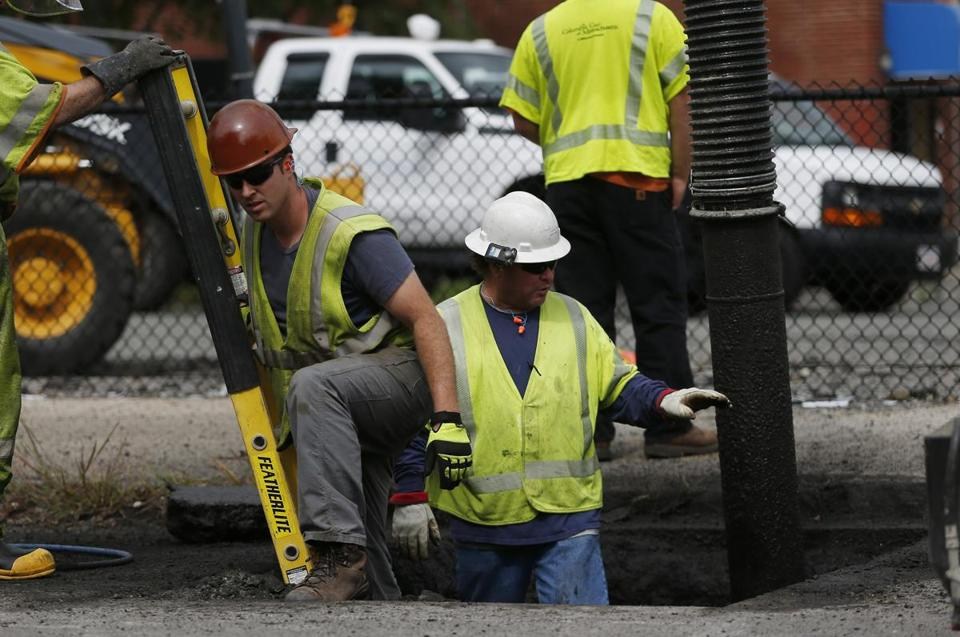Columbia Gas workers worked on pipes off of Parker Street in South Lawrence.