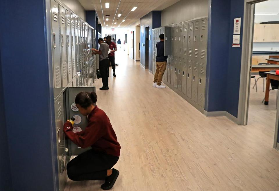 Students stopped at their lockers at the new Brooke High School and Eighth Grade Academy.