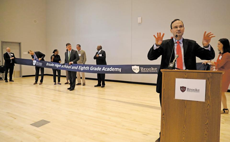 Jon Clark, co-director of Brooke Charter Schools, tried to organize the ribbon cutting ceremony at the new school.