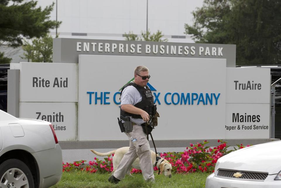 An ATF police officer walked out of the Maryland industrial complex where a woman killed three people before killing herself.