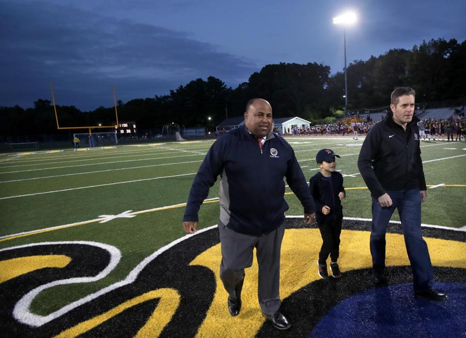 Rivera handled the coin toss at the Lawrence-Andover high school football game Friday.