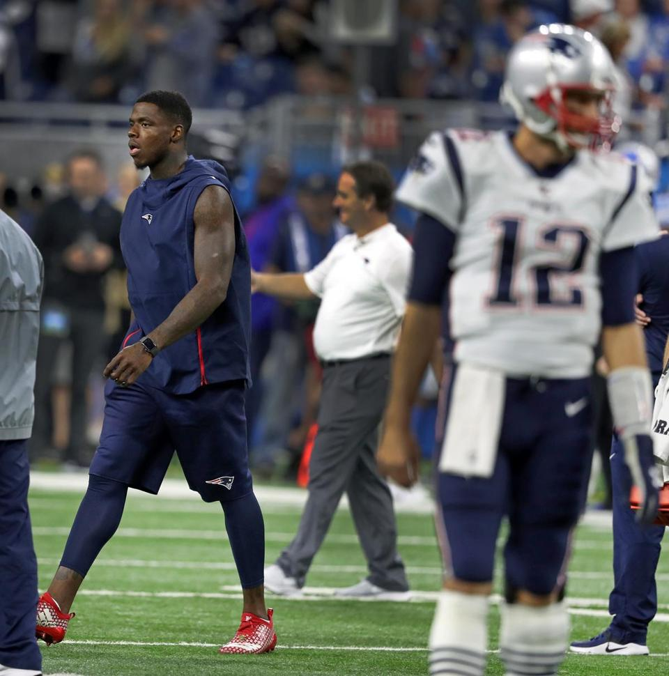 Patriots quarterback Tom Brady was in uniform on the field during pregame warmups, but wide reciever Josh Gordon (left) was not after being ruled inactive.