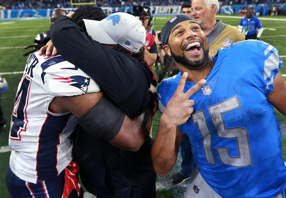As Lions coach Matt Patricia hugs Patriots linebacker Dont'a Hightower following Detroit's victory, Lions receiver Golden Tate crashed the moment with a huge smile on his face.