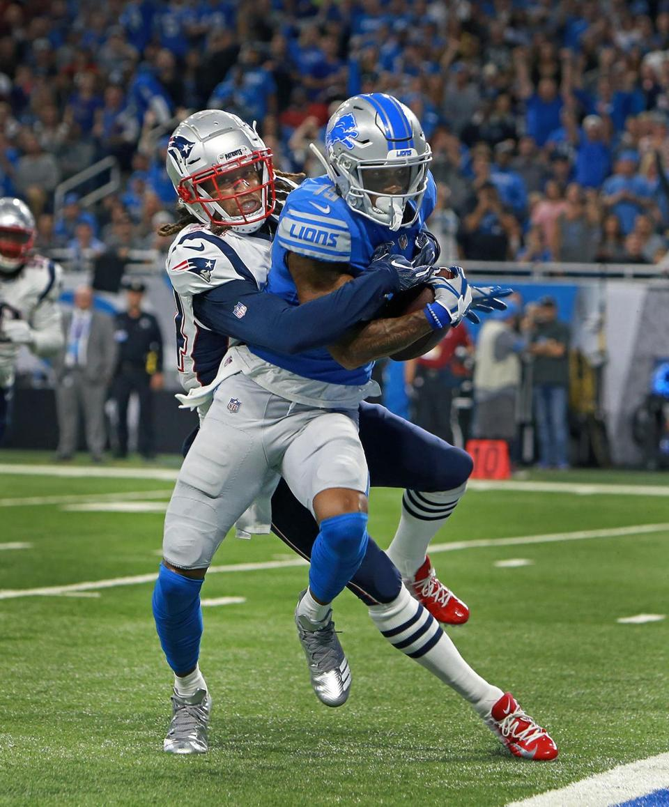Kenny Golladay drags Stephon Gilmore over the goal line as he scores a first quarter touchdown.