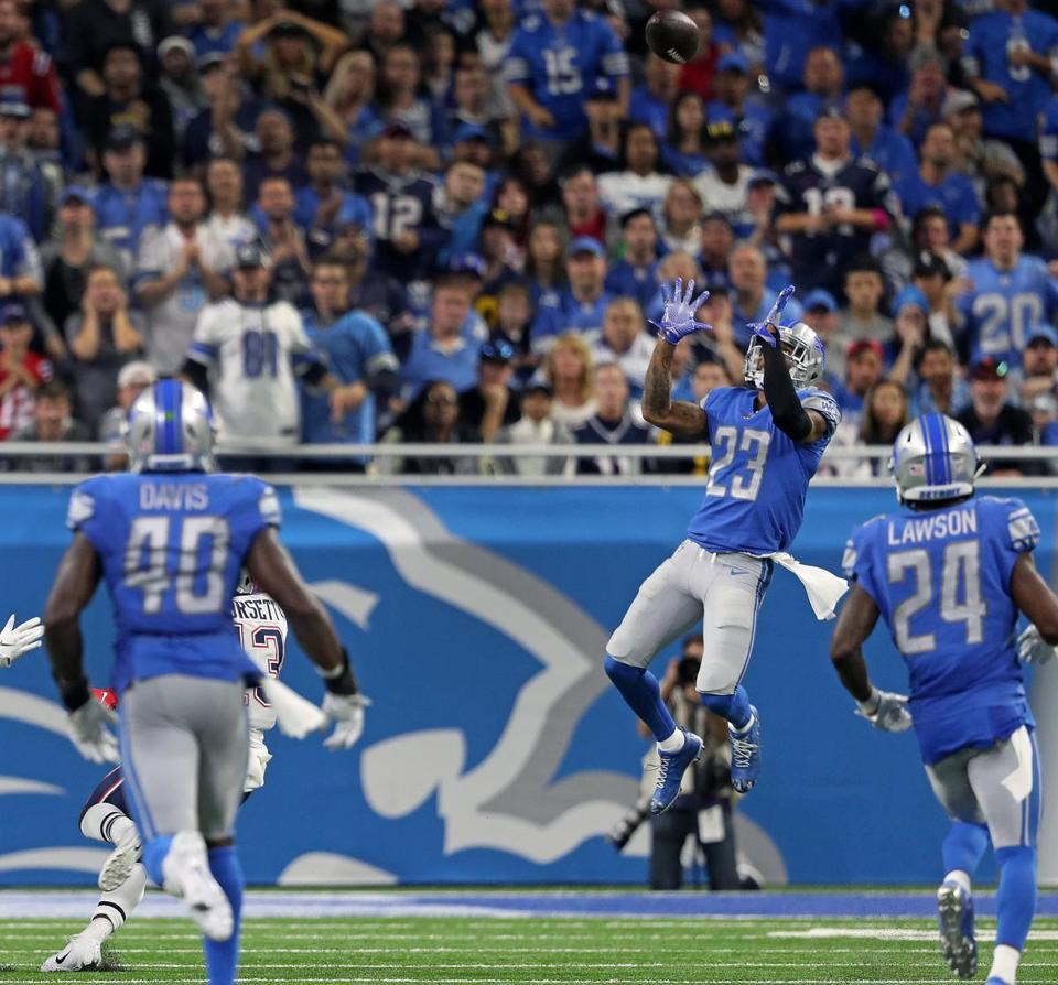Lions cornerback Darius Slay (23) is the only player near the ball, as he intercepts a fourth quarter pass from Tom Brady.