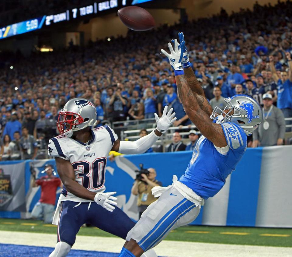 Kenny Golladay hauls in a second quarter pass in the end zone, but luckily for Jason McCourty (30) and the Patriots he came down out of bounds for an incomplete pass.