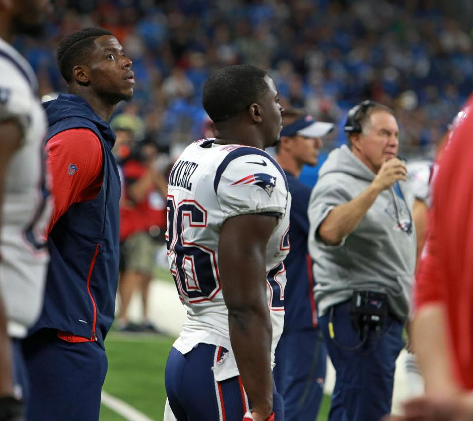 Coach Bill Belichick decided agaisnt dressing receiver Josh Gordon (left) for the game. They are pictured on the sidelines just before the start of the game.