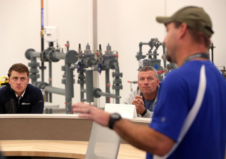 Brett Saber and Chad Hughes listened during a Columbia Gas training session in Shrewsbury.