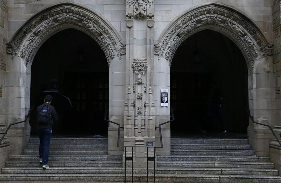 A man walked up the steps of Yale Law School.
