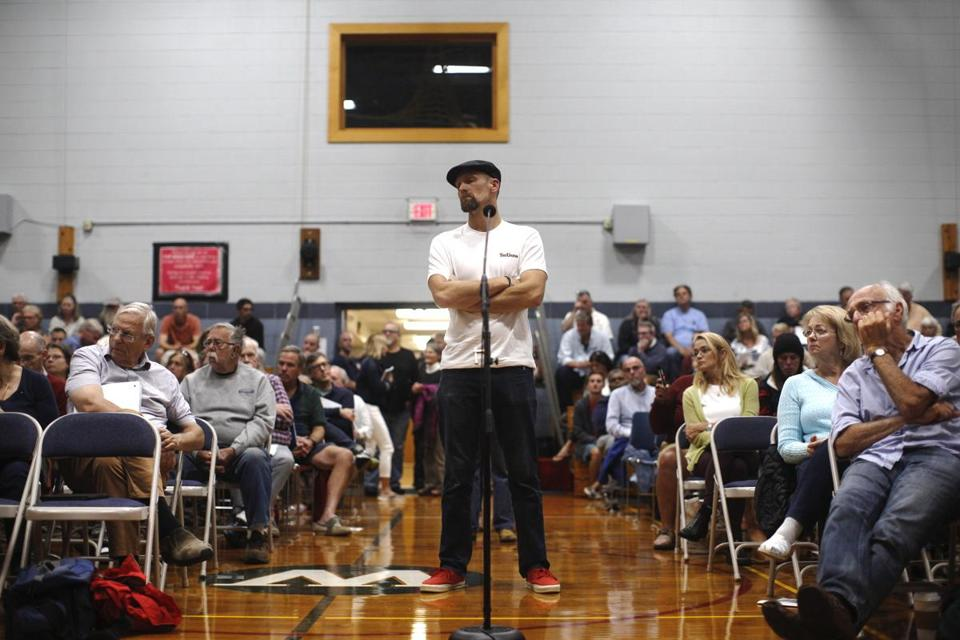 Wellfleet, MA - 9/27/2018- Olaf Valli, owner of surf shop Sick Day, expresses his concerns as a surfer at a public meeting held at Wellfleet Elementary School on Thursday, September 27, 2018. (Michael Swensen for The Boston Globe) Topic: (metro)