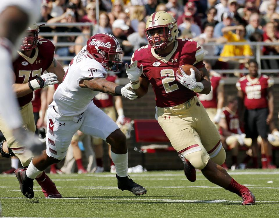 Boston College running back AJ Dillon (2) rushes with the ball ahead of Temple linebacker Shaun Bradley (5) during the first half of an NCAA college football game, Saturday, Sept. 29, 2018, in Boston. (AP Photo/Mary Schwalm)