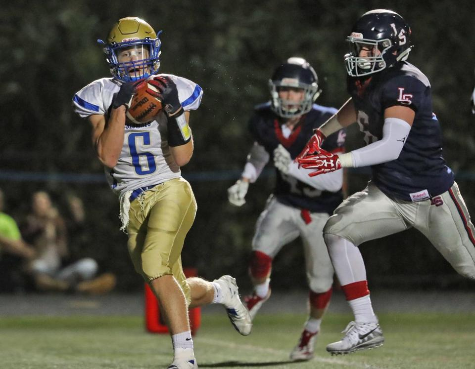 Sudbury MA 9/28/18 Action Boxboro Victor Otero hauls in a touchdown reception beating Lincoln Sudbury Ben Ohler during first half action at Lincoln Sudbury High School. (photo by Matthew J. Lee/Globe staff) topic: 26clubhousepics reporter: Allison Hagan