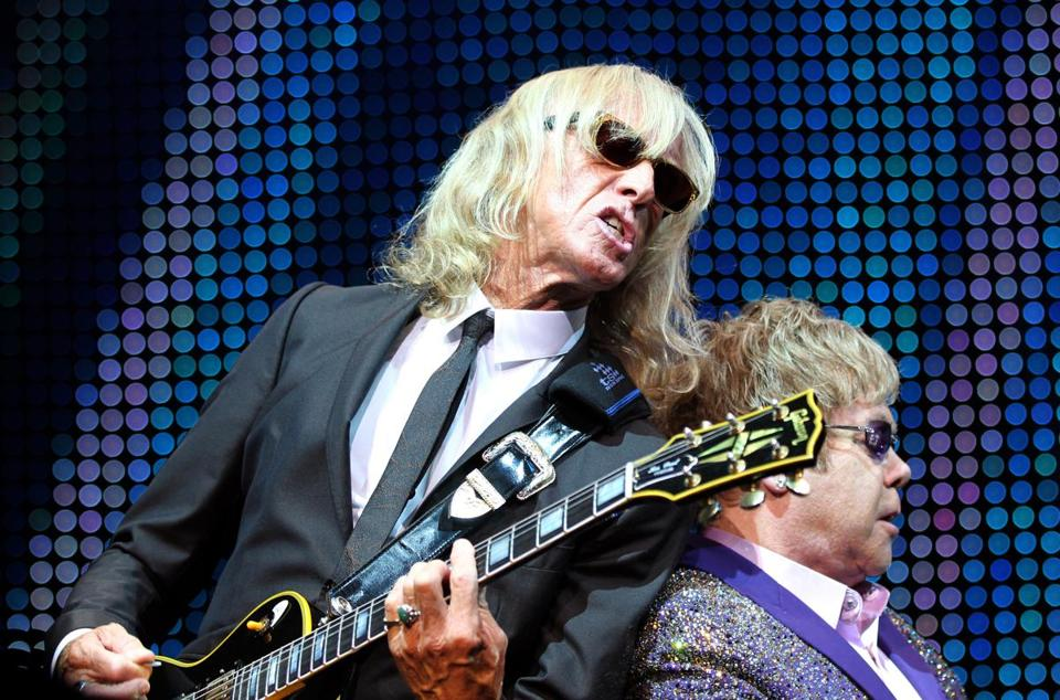Scottish rock guitarist Davey Johnstone (L) and English rock singer-songwriter Elton John perform onstage at the Palais Nikaia concert hall, on June 22, 2012 in Nice, southeastern France. AFP PHOTO/ VALERY HACHE (Photo credit should read VALERY HACHE/AFP/GettyImages) 05Elton