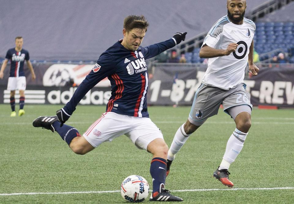 8.3.1986114320_Sports_Revolution New England Revolution midfielder Kelyn Rowe (11) takes a shot inside the 18 as Minnesota United midfielder Collen Warner (26) can only watch during the MLS soccer game at Gillette Stadium in Foxborough, Mass., Saturday, March 25, 2017. The Revs defeated Minnesota United 5-2. (Robert E. Klein for the Boston Globe)