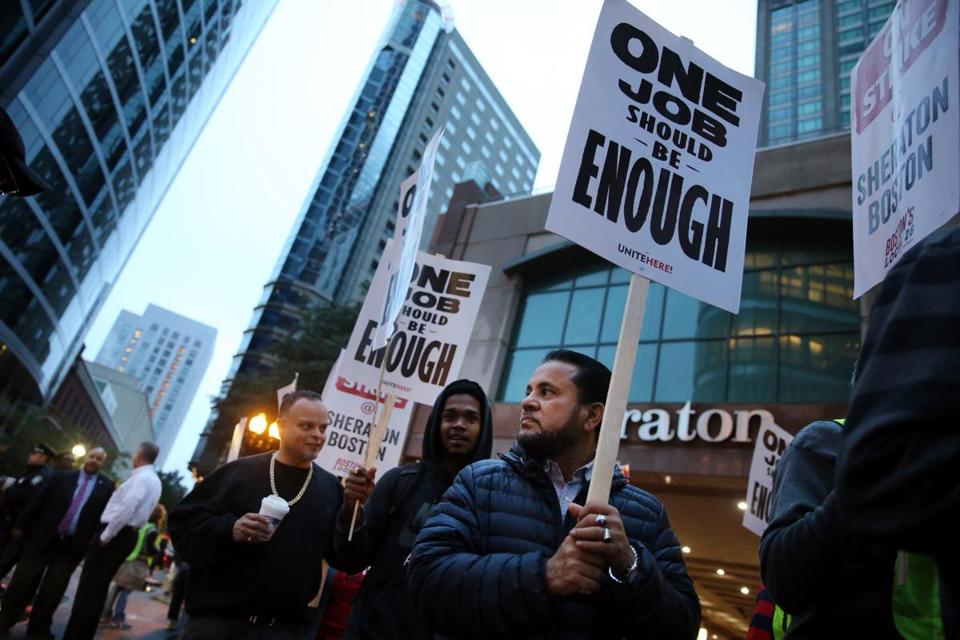 Workers and supporters picketed outside the Sheraton Boston by Marriott on Wednesday.