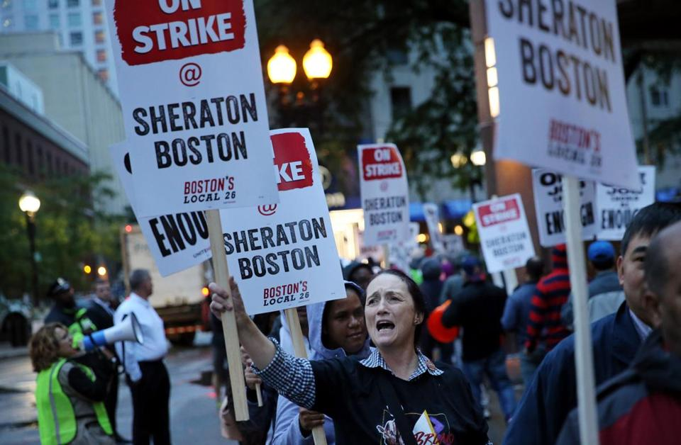 Diane Pastos picketed outside the Sheraton Boston by Marriott, where she worked as an attendant in Boston.