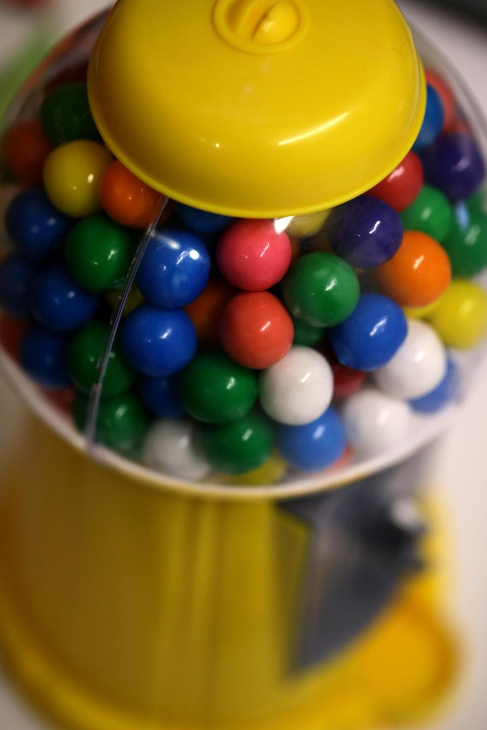 On her desk is a gumball machine, which helps symbolize to her the learning possibilities in trying something new.