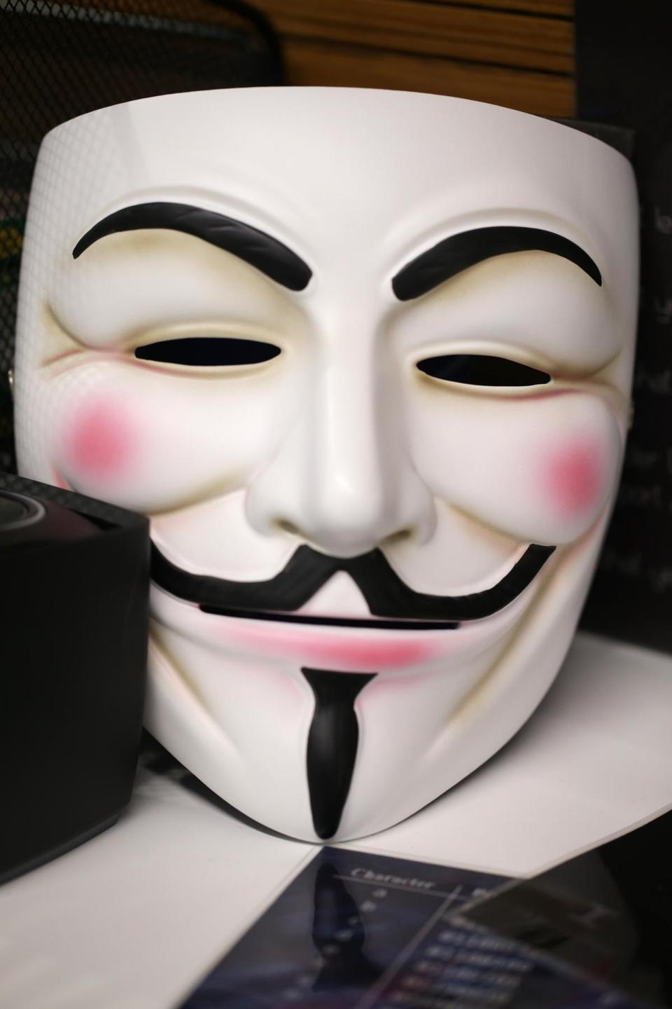 The Guy Fawkes mask is an well-known marker of hacker culture. Ritter uses this one in acting out scenarios for clients.