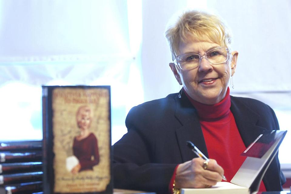 "FILE - In this Jan. 11, 2008, file photo, Peggy Sue Gerron unveils her new book ""What Ever Happened to Peggy Sue"" during a press conference in Tyler, Texas. Gerron, the Texas woman who inspired the 1958 Buddy Holly song ""Peggy Sue"" has died at a Lubbock hospital. Gerron Rackham of Lubbock died Monday, Oct. 1, 2018, at University Medical Center. She was 78. (Jaime R. Carrero/Tyler Morning Telegraph, via AP, File)"