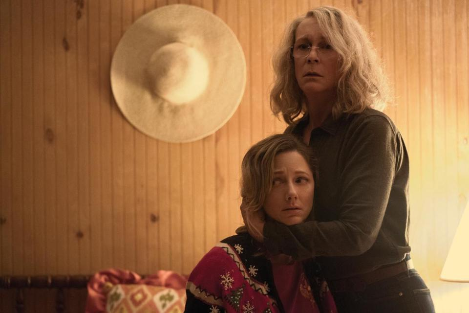 "Jamie Lee Curtis (holding Judy Greer) returns as Laurie Strode in ""Halloween."""