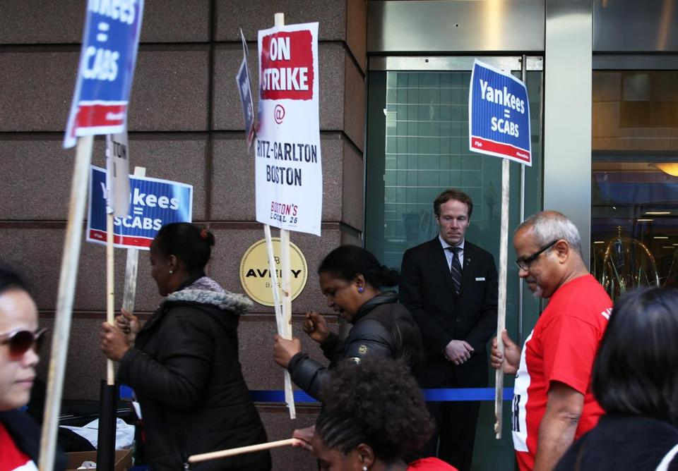 Strikers with UNITE HERE Local 26 held a picket line outside of the Ritz Carlton in Boston on Friday.